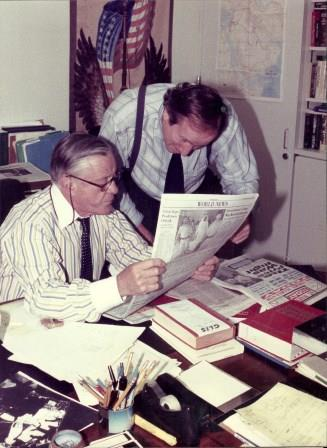 Ben Bradlee, a twenty-year subscriber to ST. MARY'S TODAY, gives a few news pointers to Ken Rossignol in his office at the Washington Post. Photo by Patrick Pena
