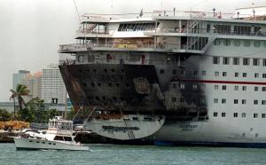 The Carnival Ecstasy fire results after the ship caught fire just after leaving port in Miami. Several large tugs were nearby to respond and pour huge streams of water on the ship.