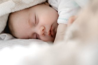 Baby sleeping with a white blanket