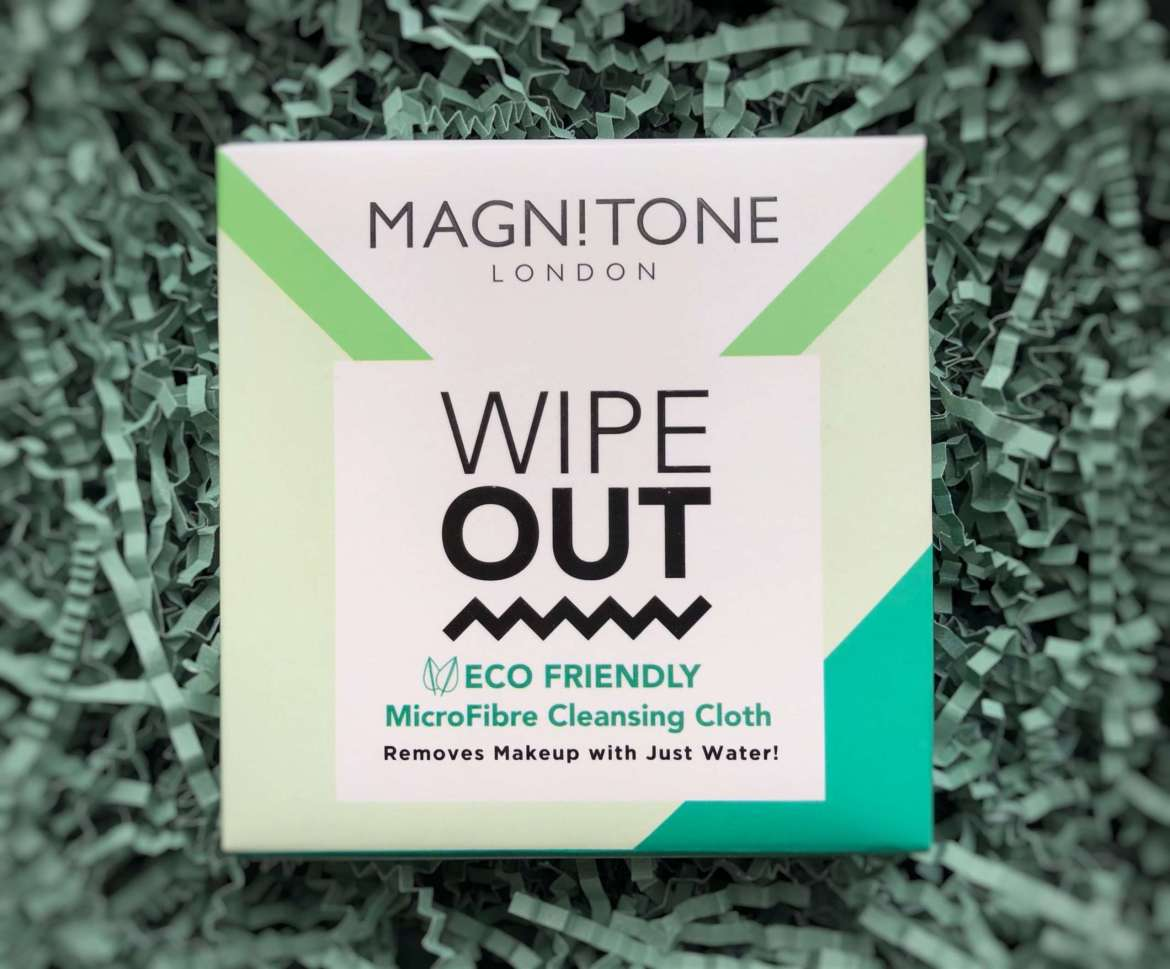 Mays lookfantasic Beauty Box - Magnitone wipe out Eco friendly microfibre cleansing cloth resting on shredded green tissue paper