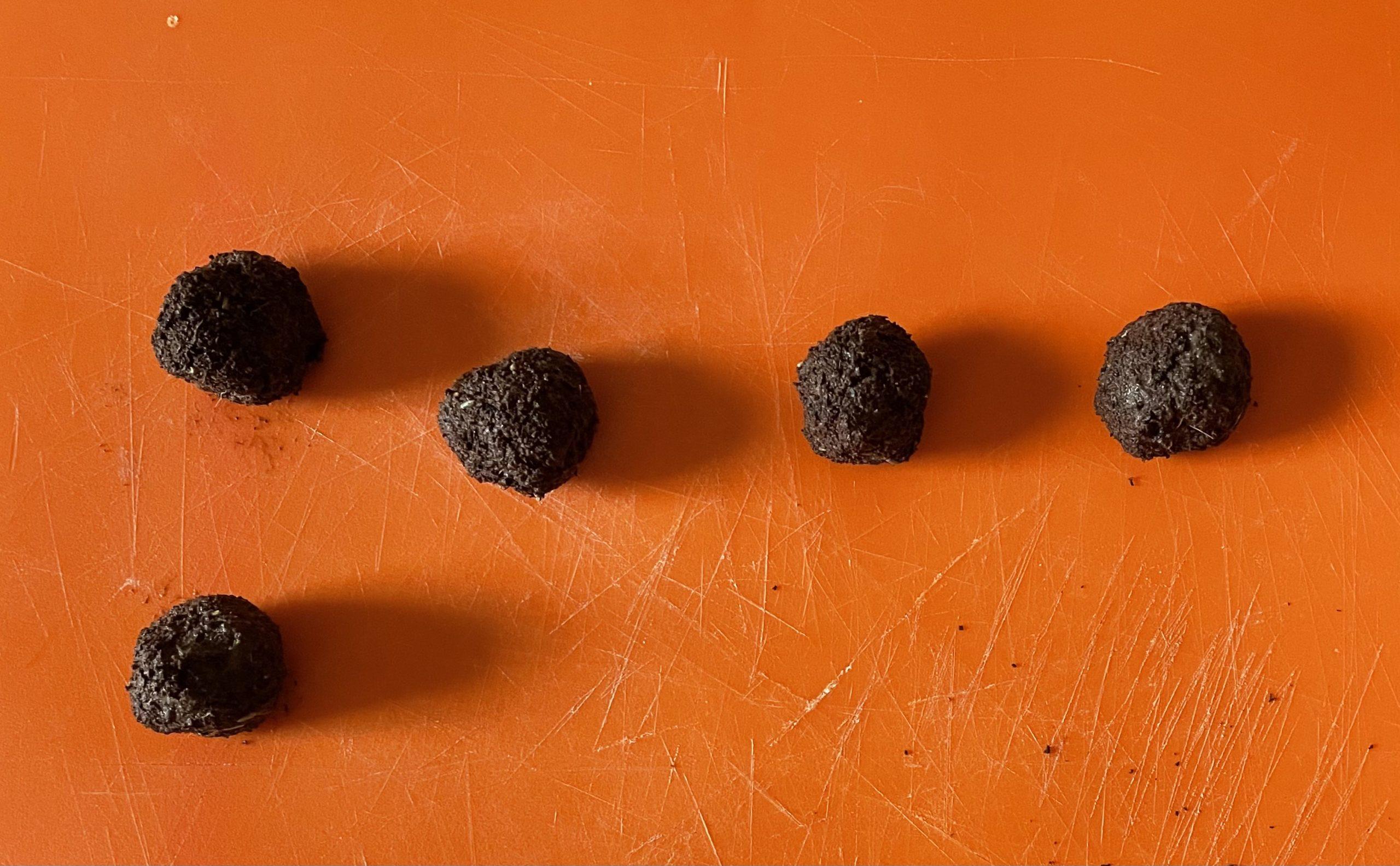5x Mud and Bloom seed bombs on an orange board