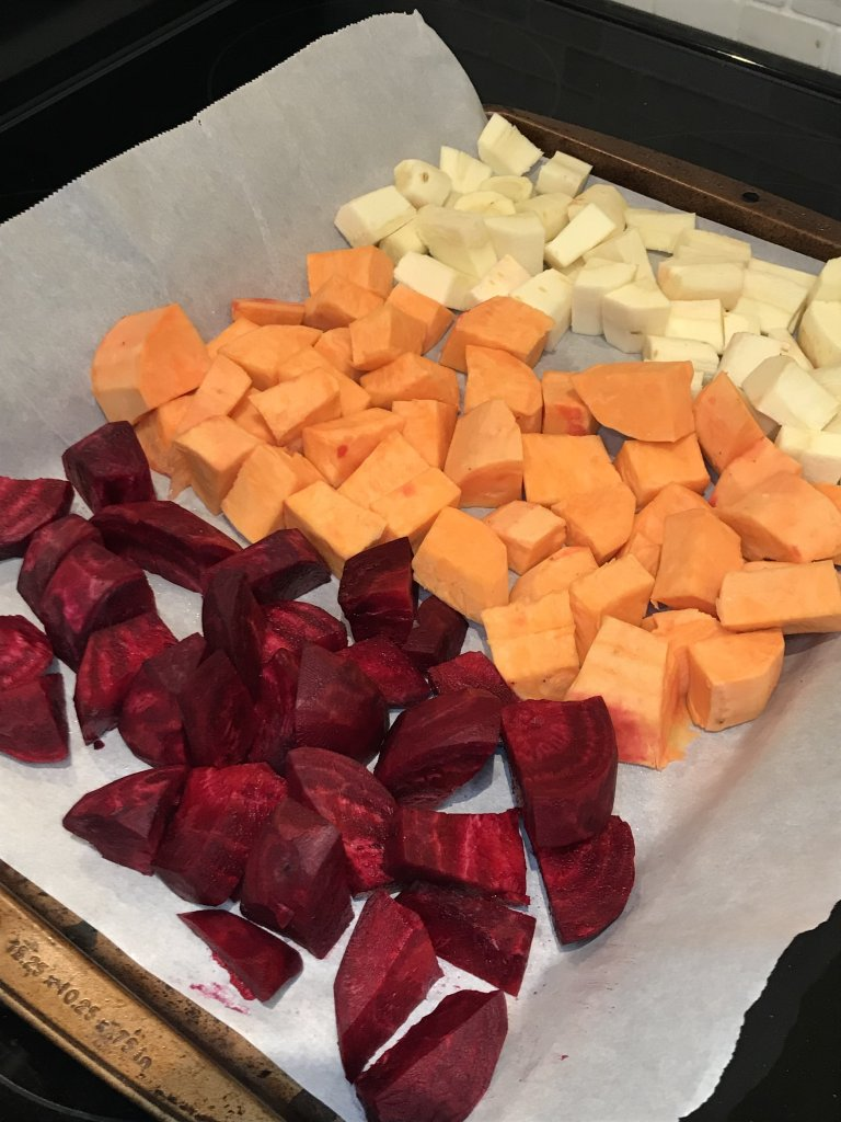 To make the best roasted root vegetables start by cubing your root vegetables including sweet potatoes, beets, parsnips, butternut squash