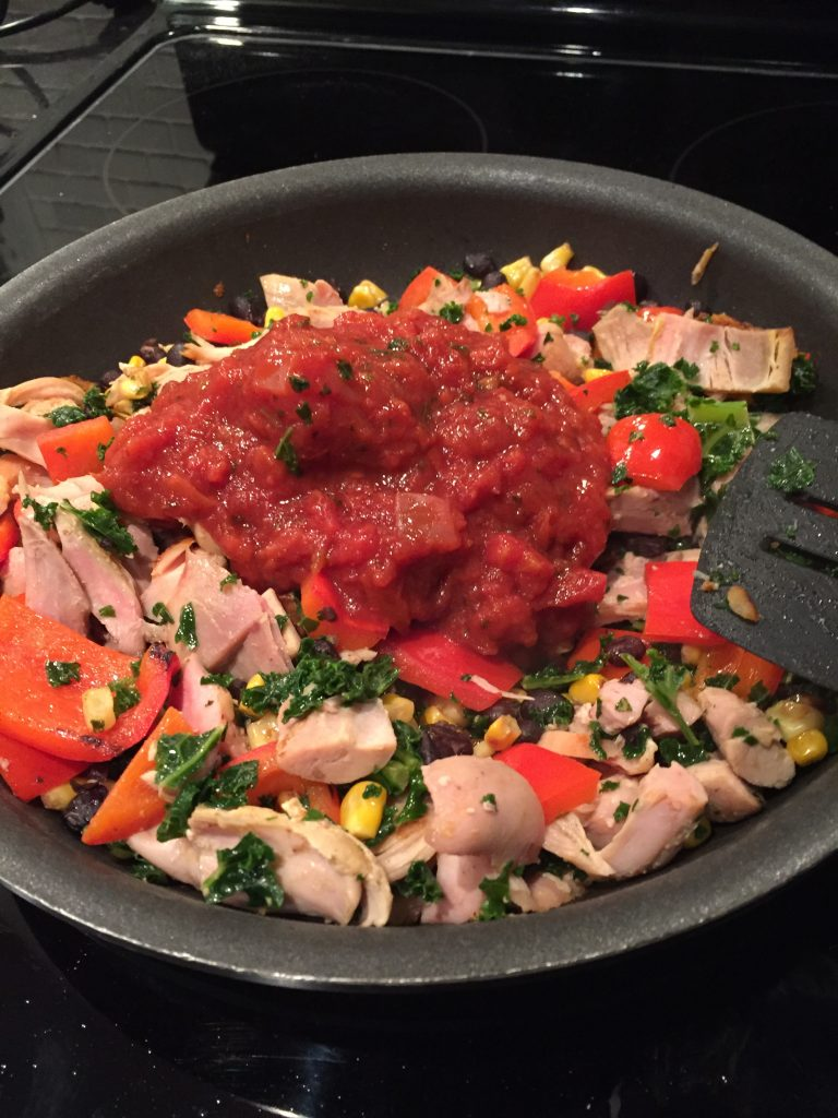 Add salsa to the chicken and vegetables to make BBQ Chicken Burrito Bowls