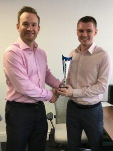 Joshua Castle receiving his Fantasy Football trophy from Alex Shaw
