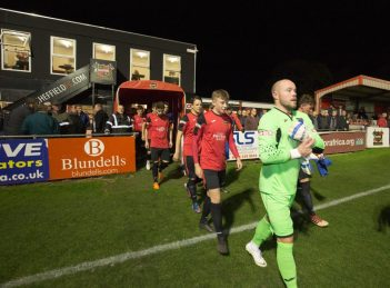 Sheffield FC players walk out onto the pitch