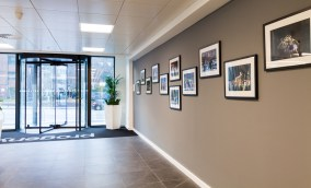 A photo of our new Leeds office's reception area, showing the community gallery space