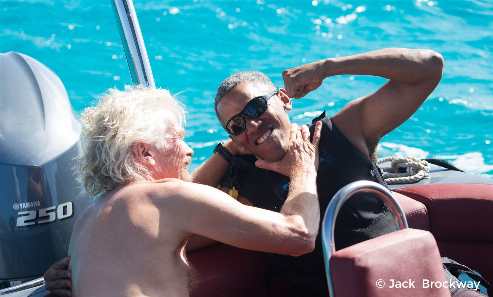 Obama w Branson play fighting beautiful turq water.jpg