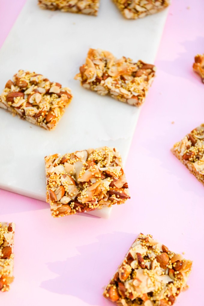 almond and coconut granola bars sitting on slab of marble