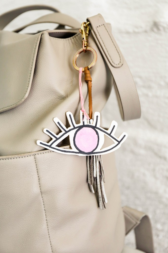 wooden eye-shaped valentines hanging as a keychain from a purse