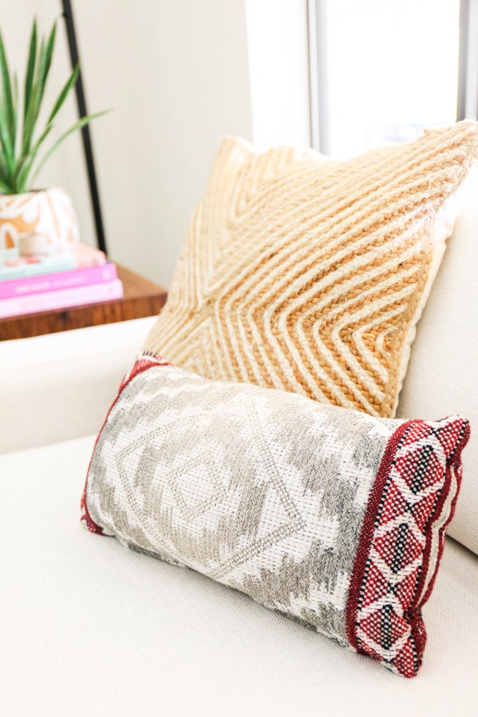 close up of pillows on white chair
