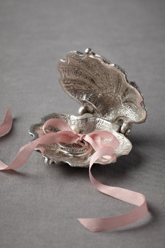 You could present the ring in a custom made seashell