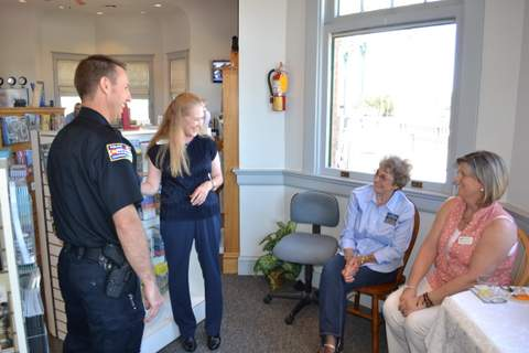 Director Leslie Stagner Shares a Moment with Staff and Lamar Police Chief Kyle Miller