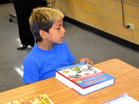 Young Student with New Book