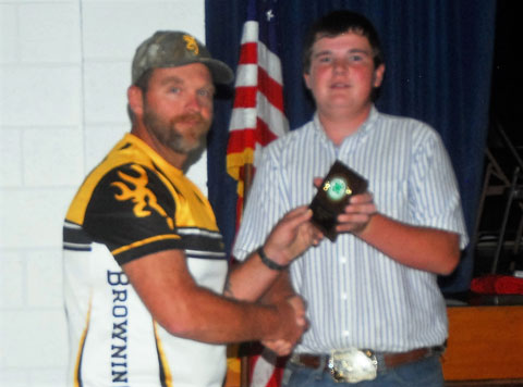 Ben Miller of the Bent County/Las Animas Trap Club is presented the Friend of 4-H award by member council officer Doug Miller.