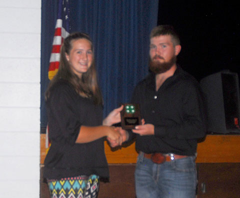 Junior Outstanding 4-H Member Cassidy Jagers receives her award from council officer Sam Cox.