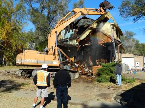 Craig Brooks and Lamar Police Chief Kyle Miller Observing Demolition