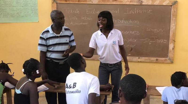 "Ms Viola Tebah, founder of ""The Tebah Educational Initiative"" interacting with some students"