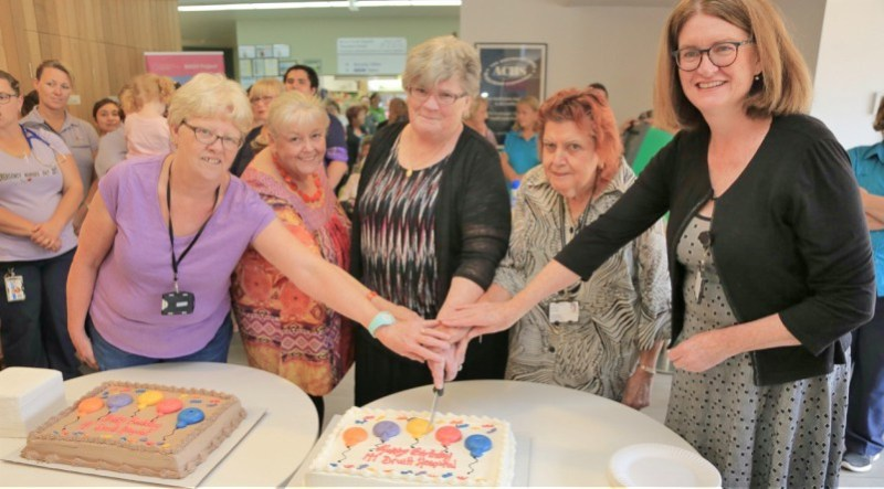 Volunteers Emily Jancek, Gayle Barbagallo, Karen Lancaster and Janice Graham, and the general manager of Blacktown and Mount Druitt hospitals Sue Anne Redmond celebrate the landmark date.
