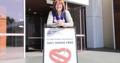 Volunteer and no smoking sign