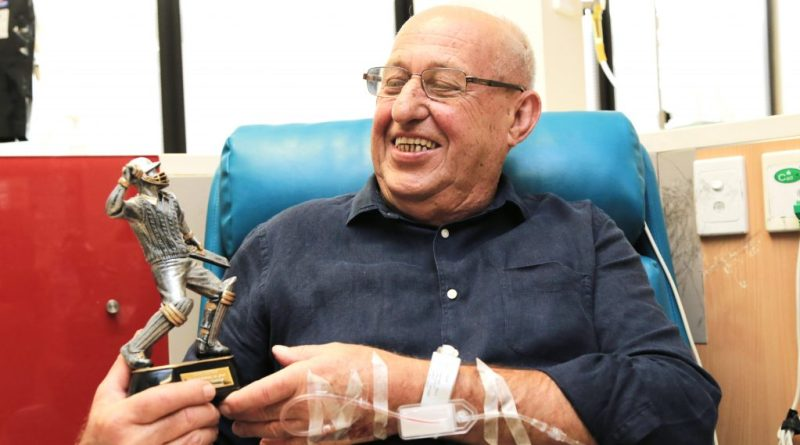 Patient looks at his trophy
