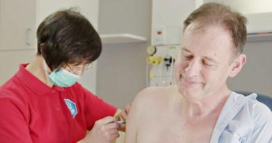 Dr Brett Gardiner receiving the flu vaccine last week,