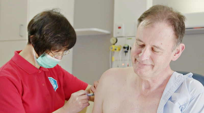 Dr Brett Gardiner receiving the flu vaccine last week,