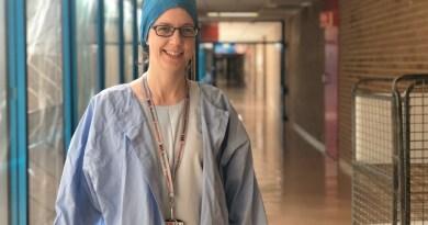 Surgeon Ann Marie in her scrubs in a Westmead Hospital corridor