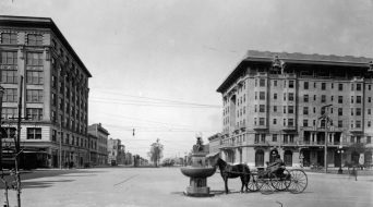View looking west down Garden Street showing the horse watering fountain on the east side of Palafox, the San Carlos Hotel and the Blount and Brent Buildings, 1912. (UWF Archives/Special to The Pulse)