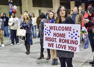 The wife of Master Sgt. Nick Rohling, a flightline expeditor with the 801st Special Operation Aircraft Maintenance Squadron, waits for his return at the Deployment Control Center, Hurlburt Field, Fla., Feb. 7, 2016. Rohling returned home from deployment along with 105 other Air Commandos. (U.S. Air Force photo by Senior Airman Jeff Parkinson)