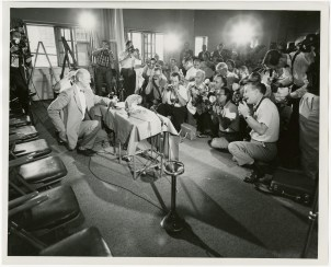 "Mr. Donald Stullken, US Navy School of Aviation Medicine, Pensacola, Florida, introduces monkeys ""Able"" and ""Baker"" at a NASA Press Conference, May 30, 1959."