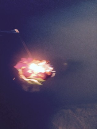 A little diya bobs in the river current