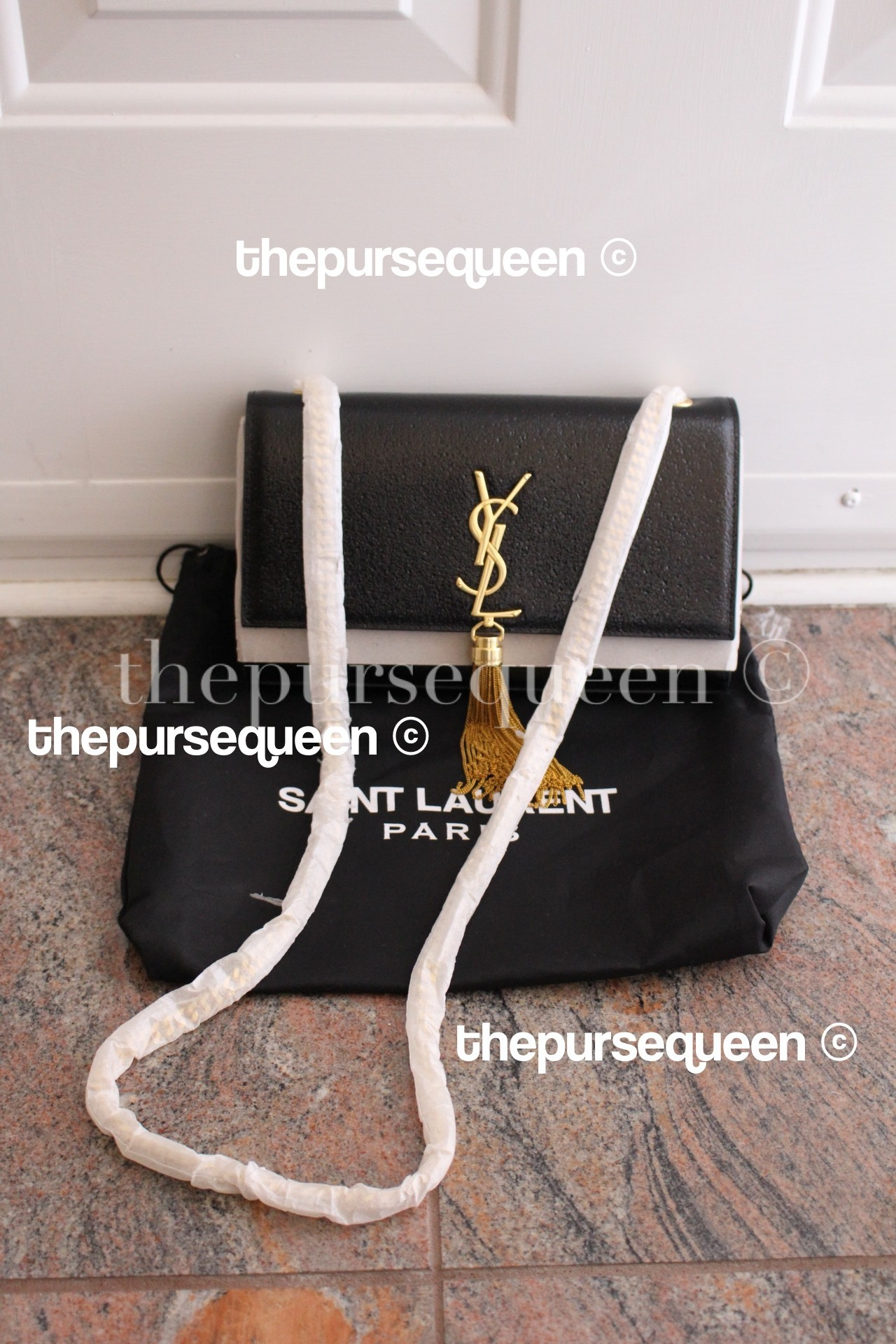 yves-saint-laurent-cassandre-replica-authentic-fake-real-designer-discreet