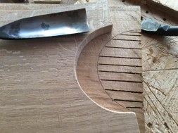 The waste is chiselled out with a firmer chisel and the arc pared with a gouge