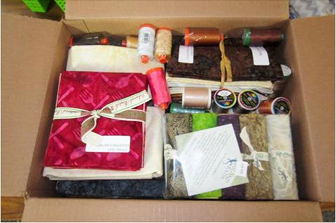 Opening a box of Island Batik Fabrics