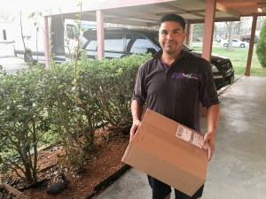 Fedex man delivering Island Batik Fabrics to the Quilt Rambler