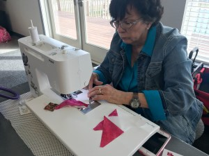 Janie is enjoying piecing together fabrics cut with the GoCutter