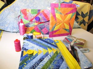 Three fabric covered notebooks designed by The Quilt Rambler