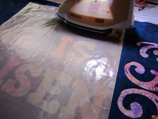 Photo shows an Appliqué pressing sheet as a protection from sticky fusible transferring to the iron when adhering any sort of raw edge appliqué