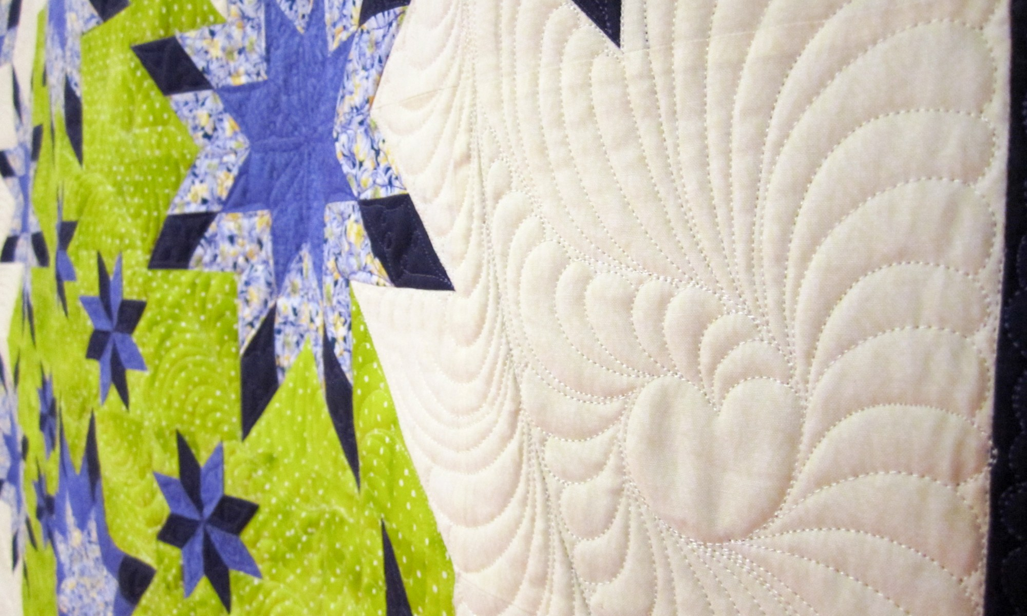 Close up of hand guided quilting design element by Karen Overton
