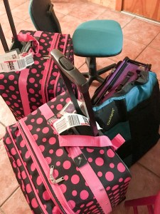 pink poka dot suitcases full of quilting supplies for a quilting workshop