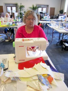 Mindy is happily sewing her workshop project