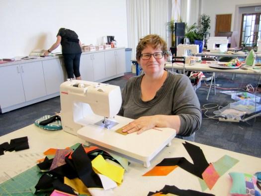 smiling lady at sewing machine