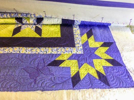 Karen Overton's signature butterfly quilted on the bottom border of Morning Glory a quilt by Deb Tucker