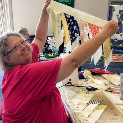 student shows her progress in quilting workshop