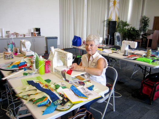 student sewing in quilting workshop