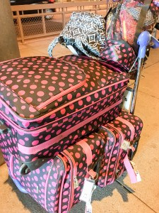 Three hot pink polka dot suitcases are full of quilts to take to Arizona