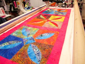 Curved Pieced Quilt on the Longarm