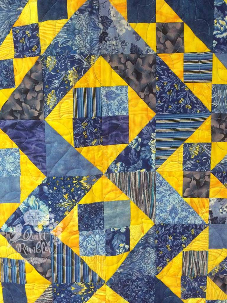For Elise is a quilt made of blue and yellow shaded four patch units