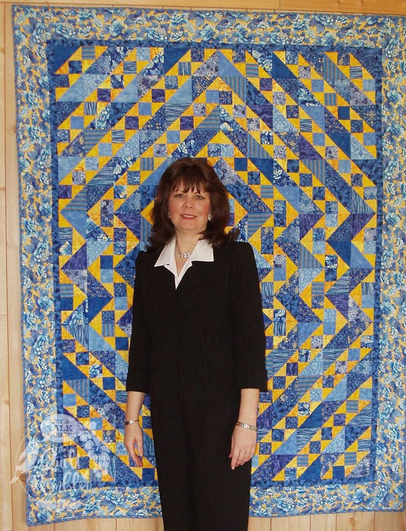 For Elise is a blue and yellow quilt make by Karen Elise Overton shown in the photo