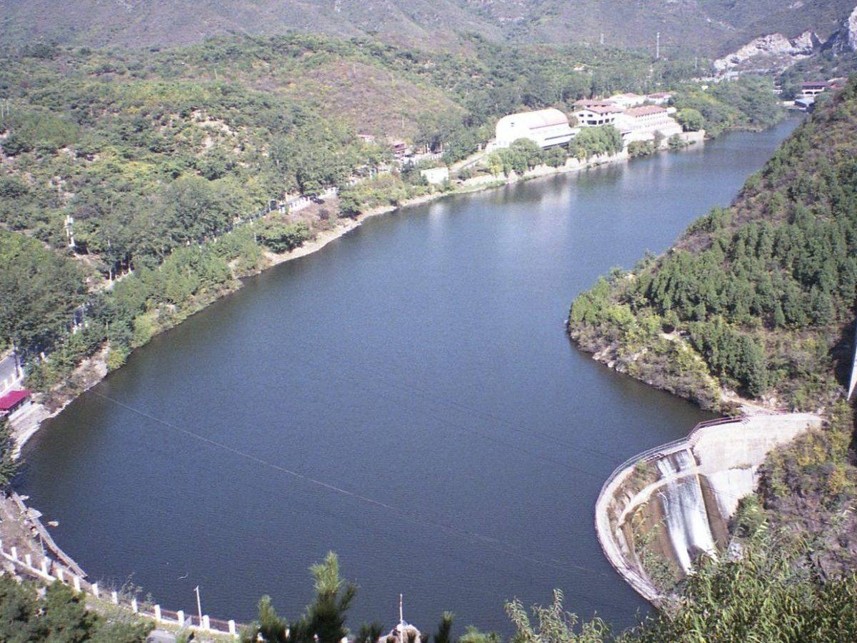 wide lake in green mountainous terrain